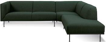 Nancy stilren grøn sofa i stofbetræk og sortlakeret metal ben